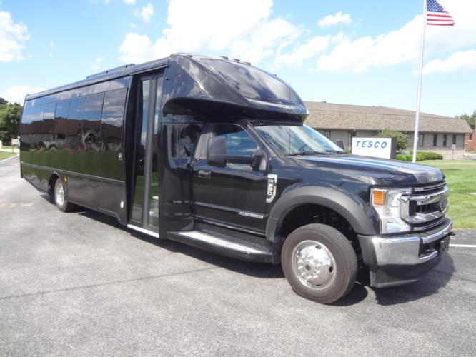 2020 Turtle Top Odyssey XL Ford 28 Passenger Luxury Bus Passenger side exterior front angle-108531-1
