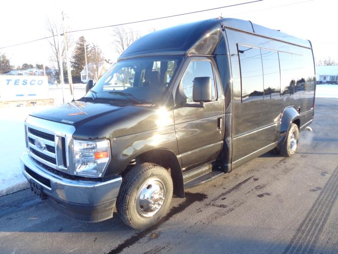 2022 Turtle Top VanTerra Ford 13 Passenger Luxury Bus Driver side exterior front angle-397306-2