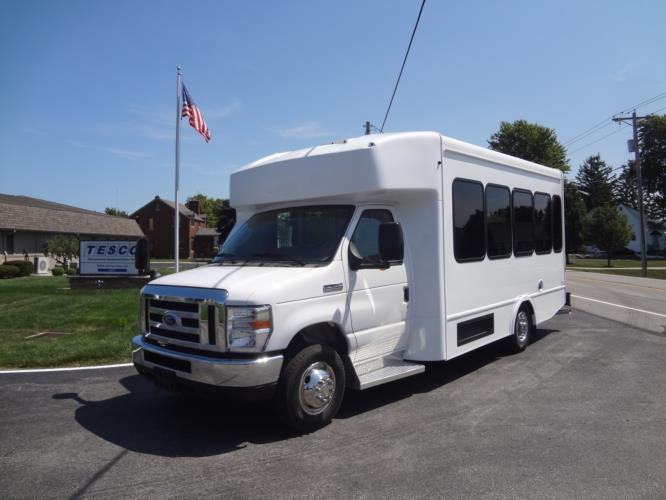 2021 Turtle Top Terra Transit Ford 14 Passenger Shuttle Bus Driver side exterior front angle-501340-2