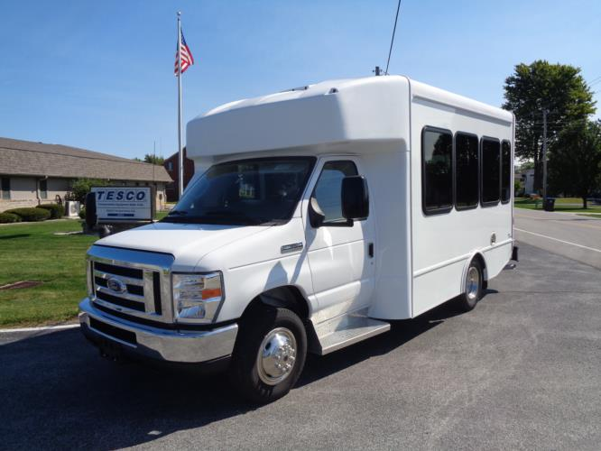 2021 Turtle Top Terra Transit Ford 14 Passenger Shuttle Bus Driver side exterior front angle-501353-2