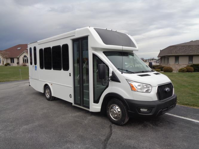 2020 Turtle Top Terra Transit LD Ford 7 Passenger and 3 Wheelchair Shuttle Bus Passenger side exterior front angle-501617-1