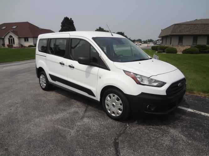 2021 Ford Transit Ford 3 Passenger and 1 Wheelchair Van Passenger side exterior front angle-ATS1153-1