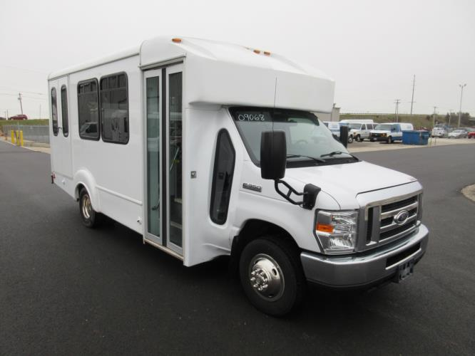 2016 Goshen Coach Ford 12 Passenger and 2 Wheelchair Shuttle Bus Passenger side exterior front angle-09068-1