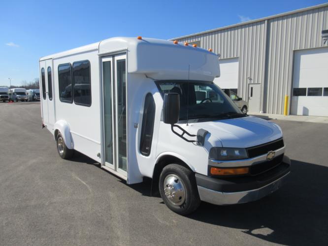 2012 Goshen Coach Chevrolet 9 Passenger and 1 Wheelchair Shuttle Bus Passenger side exterior front angle-09126-1