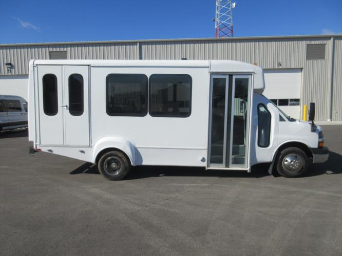 2012 Goshen Coach Chevrolet 9 Passenger and 1 Wheelchair Shuttle Bus Driver side exterior front angle-09126-2