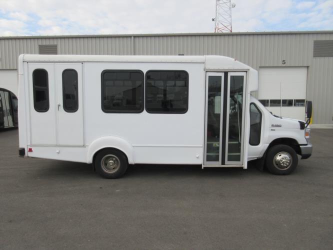 2016 Goshen Coach Ford 12 Passenger and 2 Wheelchair Shuttle Bus Driver side exterior front angle-09169-2