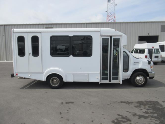 2016 Goshen Coach Ford E350 10 Passenger and 2 Wheelchair Shuttle Bus Driver side exterior front angle-09343-2