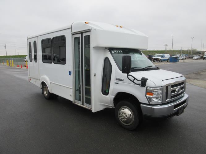 2016 Goshen Coach Ford E350 12 Passenger and 2 Wheelchair Shuttle Bus Passenger side exterior front angle-09387-1