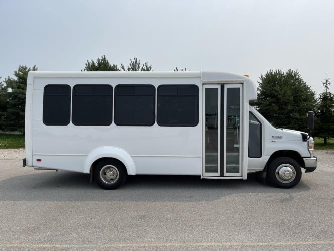 2016 Elkhart Coach Ford E350 14 Passenger Shuttle Bus Driver side exterior front angle-09475-2