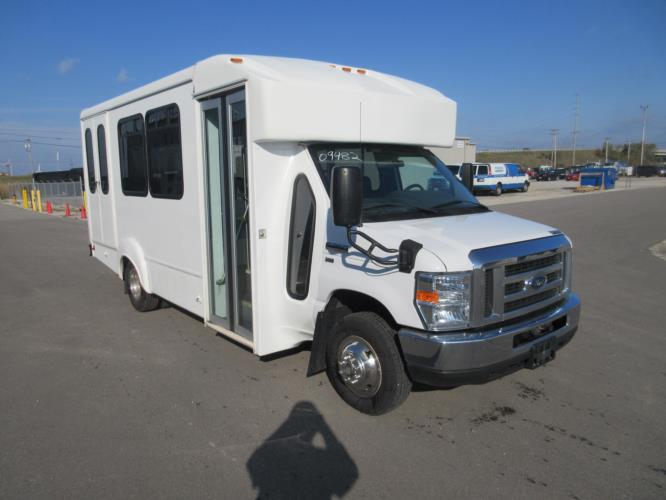 2016 Goshen Coach Ford E350 12 Passenger and 2 Wheelchair Shuttle Bus Passenger side exterior front angle-09482-1