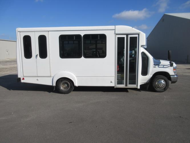2016 Goshen Coach Ford E350 12 Passenger and 2 Wheelchair Shuttle Bus Driver side exterior front angle-09482-2