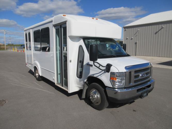 2017 Goshen Coach Ford E350 12 Passenger and 2 Wheelchair Shuttle Bus Passenger side exterior front angle-09532-1