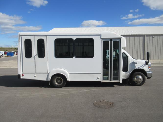 2017 Goshen Coach Ford E350 12 Passenger and 2 Wheelchair Shuttle Bus Driver side exterior front angle-09532-2