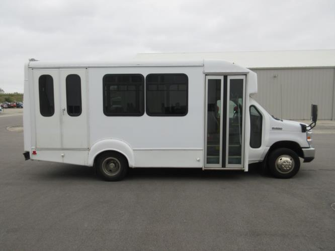 2017 Goshen Coach Ford E350 12 Passenger and 2 Wheelchair Shuttle Bus Driver side exterior front angle-09533-2