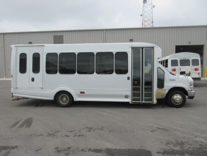 2008 Turtle Top Ford E450 8 Passenger and 4 Wheelchair Shuttle Bus Driver side exterior front angle-09541-2