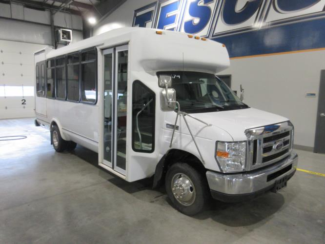 2016 ElDorado Ford E450 6 Passenger and 4 Wheelchair Shuttle Bus Passenger side exterior front angle-09674-1