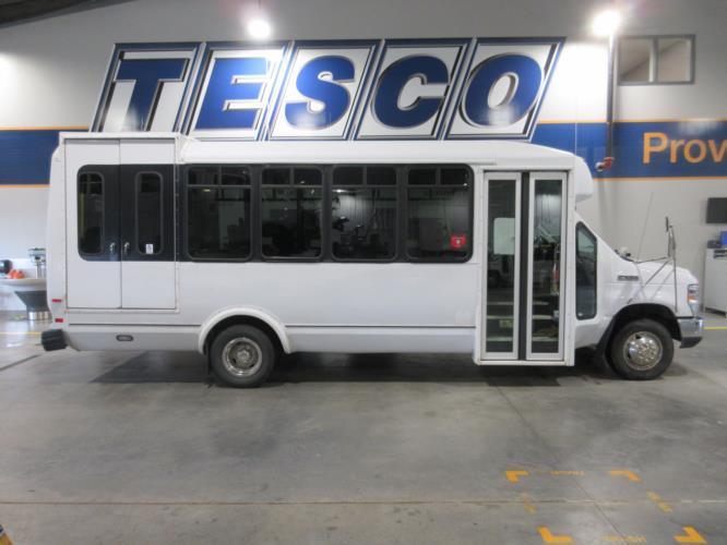 2016 ElDorado Ford E450 6 Passenger and 4 Wheelchair Shuttle Bus Driver side exterior front angle-09674-2