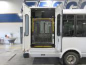 2016 ElDorado Ford E450 6 Passenger and 4 Wheelchair Shuttle Bus Passenger side exterior rear angle-09674-3