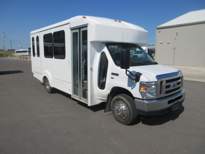 2016 Goshen Coach Ford E350 12 Passenger and 2 Wheelchair Shuttle Bus Passenger side exterior front angle-09893-1