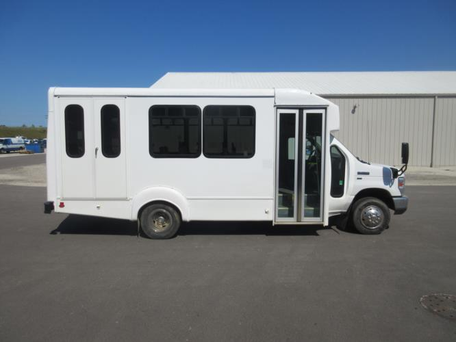 2016 Goshen Coach Ford E350 12 Passenger and 2 Wheelchair Shuttle Bus Driver side exterior front angle-09893-2