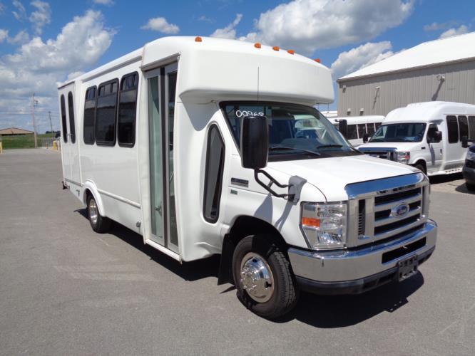 2012 Goshen Coach Ford 12 Passenger and 2 Wheelchair Shuttle Bus Passenger side exterior front angle-09968-1