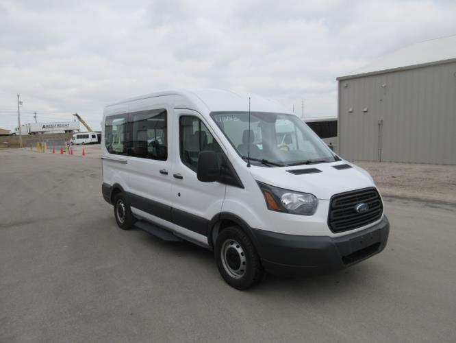 2018 Transit Ford 4 Passenger and 1 Wheelchair Van Passenger side exterior front angle-U10013-1