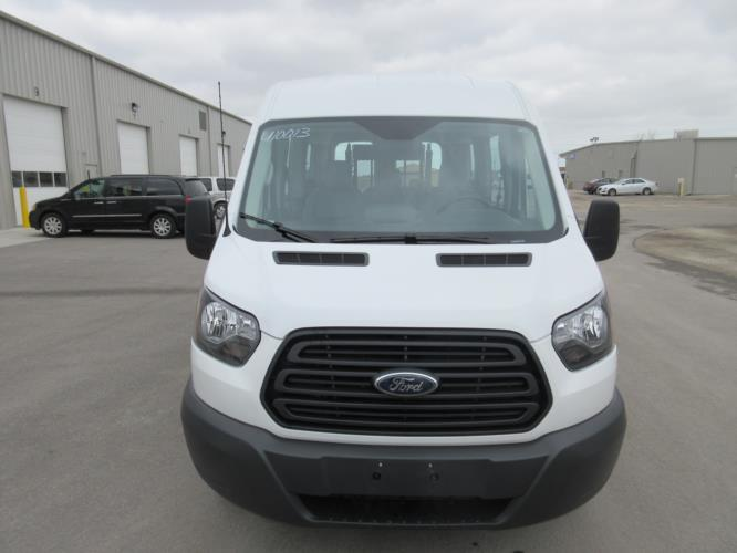 2018 Transit Ford 4 Passenger and 1 Wheelchair Van Driver side exterior front angle-U10013-2