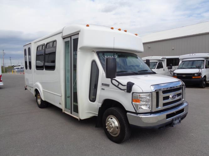 2015 Goshen Coach Ford 12 Passenger and 2 Wheelchair Shuttle Bus Passenger side exterior front angle-U10067-1