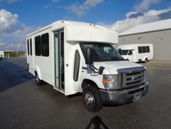2014 Goshen Coach Ford 12 Passenger and 2 Wheelchair Shuttle Bus Passenger side exterior front angle-U10069-1