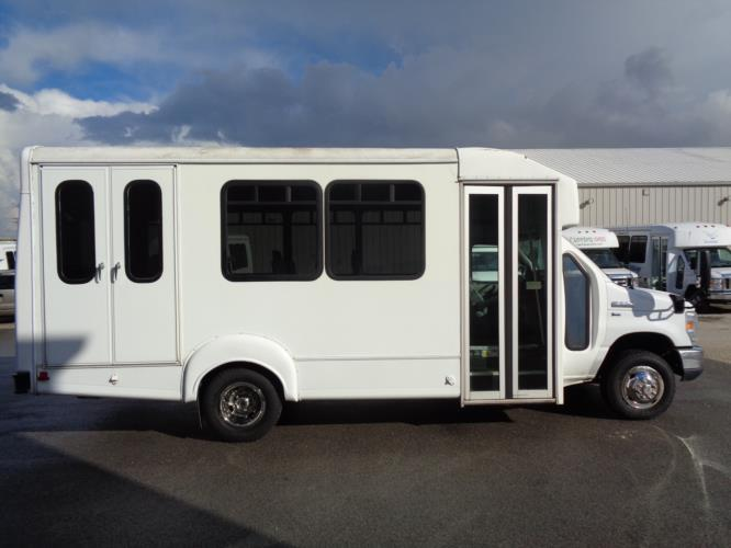 2014 Goshen Coach Ford 12 Passenger and 2 Wheelchair Shuttle Bus Driver side exterior front angle-U10069-2