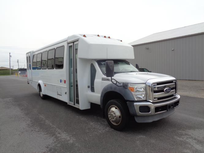 2011 Goshen Coach Ford 24 Passenger and 2 Wheelchair Shuttle Bus Passenger side exterior front angle-U10079-1