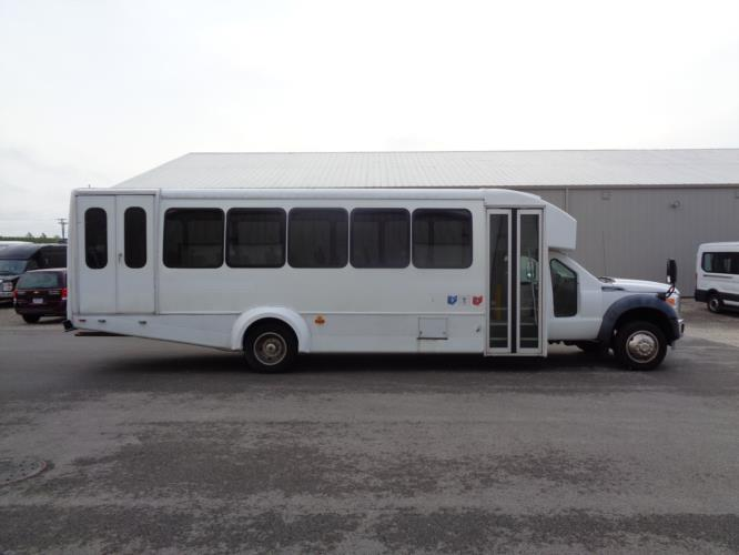 2011 Goshen Coach Ford 24 Passenger and 2 Wheelchair Shuttle Bus Driver side exterior front angle-U10079-2