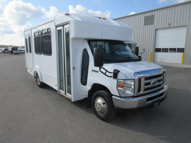 2015 Goshen Coach Ford 12 Passenger and 2 Wheelchair Shuttle Bus Passenger side exterior front angle-U10092-1