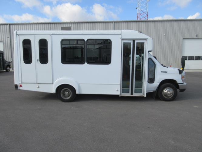 2015 Goshen Coach Ford 12 Passenger and 2 Wheelchair Shuttle Bus Driver side exterior front angle-U10092-2