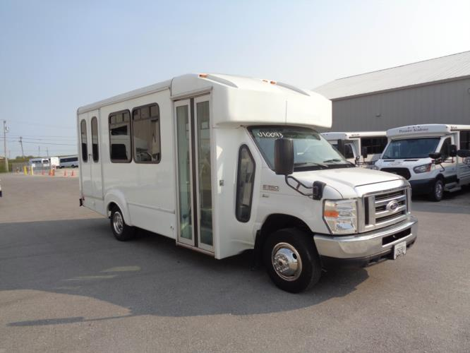 2015 Goshen Coach Ford 12 Passenger and 2 Wheelchair Shuttle Bus Passenger side exterior front angle-U10093-1