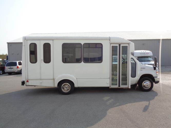 2015 Goshen Coach Ford 12 Passenger and 2 Wheelchair Shuttle Bus Driver side exterior front angle-U10093-2