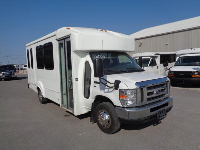 2015 Goshen Coach Ford 12 Passenger and 2 Wheelchair Shuttle Bus Passenger side exterior front angle-U10094-1