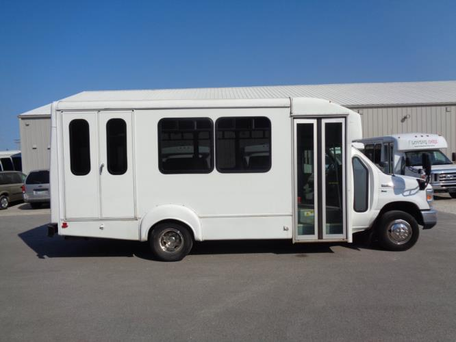 2015 Goshen Coach Ford 12 Passenger and 2 Wheelchair Shuttle Bus Driver side exterior front angle-U10094-2