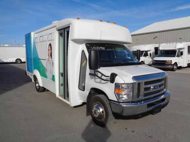 2017 Elkhart Coach Ford 12 Passenger and 2 Wheelchair Specialty Vehicle Passenger side exterior front angle-U10098-1