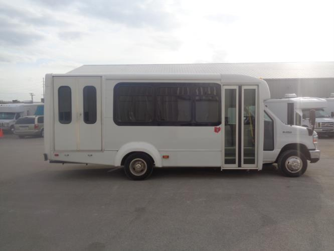 2017 Elkhart Coach Ford 12 Passenger and 2 Wheelchair Shuttle Bus Driver side exterior front angle-U10101-2
