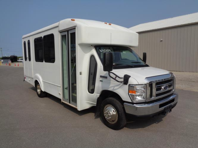 2015 Goshen Coach Ford 12 Passenger and 2 Wheelchair Shuttle Bus Passenger side exterior front angle-U10109-1