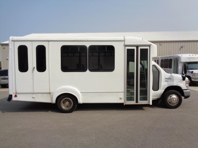 2015 Goshen Coach Ford 12 Passenger and 2 Wheelchair Shuttle Bus Driver side exterior front angle-U10109-2