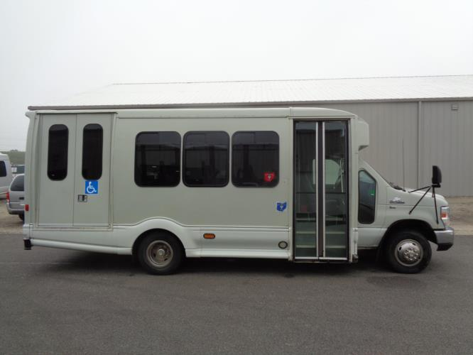 2012 Turtle Top Ford 12 Passenger and 2 Wheelchair Shuttle Bus Driver side exterior front angle-U10127-2