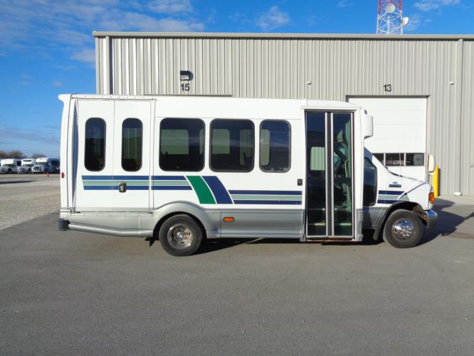 2006 Turtle Top Ford 12 Passenger and 2 Wheelchair Shuttle Bus Driver side exterior front angle-U10189-2
