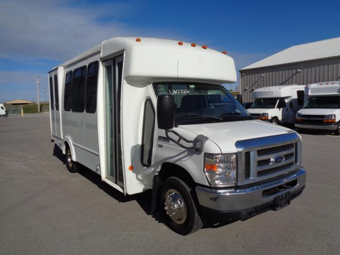 2013 Goshen Coach Ford 12 Passenger and 2 Wheelchair Shuttle Bus Passenger side exterior front angle-U10222-1
