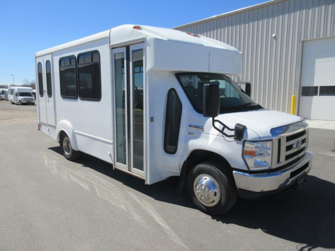 2016 Goshen Coach Ford 12 Passenger and 2 Wheelchair Shuttle Bus Passenger side exterior front angle-U10262-1