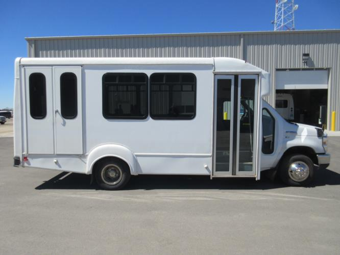 2016 Goshen Coach Ford 12 Passenger and 2 Wheelchair Shuttle Bus Driver side exterior front angle-U10262-2