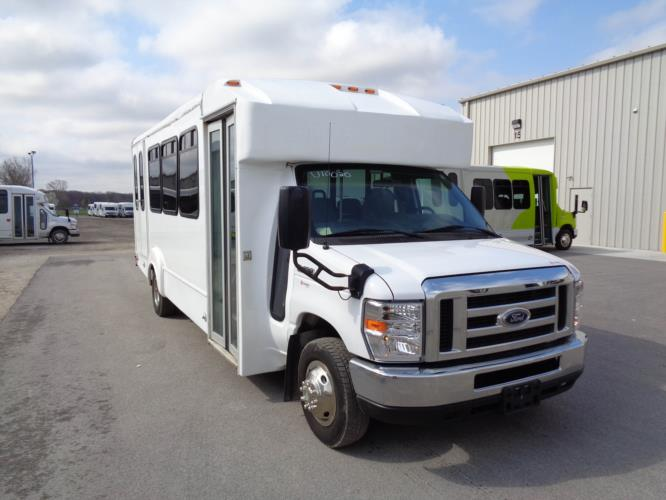 2014 Goshen Coach Ford 16 Passenger and 2 Wheelchair Shuttle Bus Passenger side exterior front angle-U10352-1