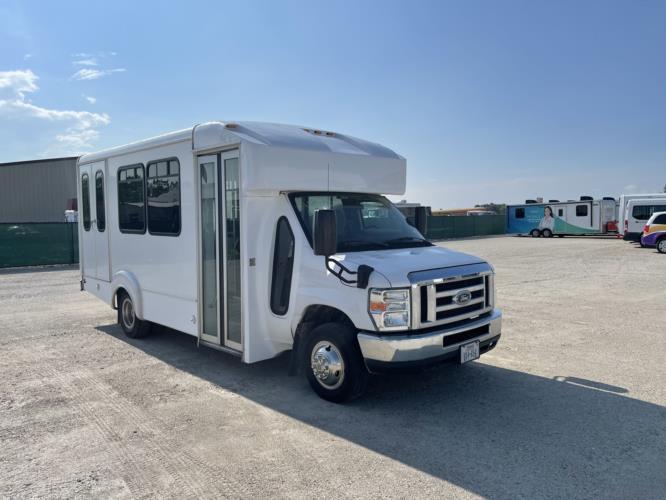 2016 Goshen Ford 12 Passenger and 2 Wheelchair Shuttle Bus Passenger side exterior front angle-U10379-1