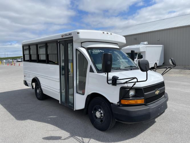 2016 Collins Chevrolet 14 Passenger Child Care Bus Passenger side exterior front angle-U10396-1